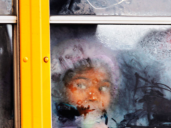 Contrary to what a SEPTA alert had said, the School District of Philadelphia WILL be closed as scheduled on Monday for Presidents´ Day. A student looks out the frosted window of a school bus as it moves down 19th Street on Tuesday, January 7, 2014. (MICHAEL S. WIRTZ / staff photographer)
