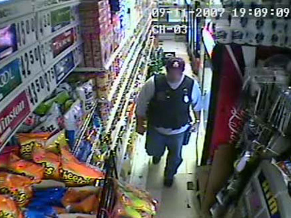 Surveillance video still of then Philadelphia Police Sergeant Joseph Bologna, now a lieutenant, during a raid of a West Oak Lane grocery store on September 11, 2007.