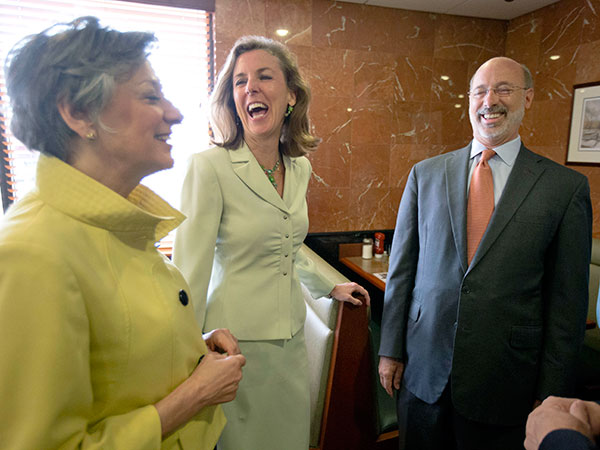 Pa. Democratic gubernatorial nominee Tom Wolf, right, former state Environmental Protection Secretary Katie McGinty, center, and U.S. Rep. Allyson Schwartz, D-Pa., meet before a meal at the Oregon Diner, Friday, May 23, 2014, in Philadelphia. (AP Photo/Matt Rourke/File photo)