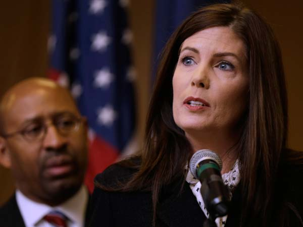 Pennsylvania Attorney Gen. Kathleen Kane, accompanied by Philadelphia Mayor Michael Nutter, speaks during a news conference Friday, Feb. 8, 2013, in Philadelphia, as she announces that Pennsylvania officials are closing a gun-law loophole that lets residents get permits online from Florida, sometimes when they can´t get them at home. (AP Photo/Matt Rourke)