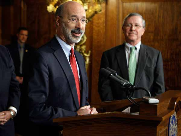 File: Tom Wolf, left, addresses  the media during a news conference at the Capitol in Harrisburg, Pa., Wednesday, Nov. 12, 2008. (AP Photo/Carolyn Kaster)