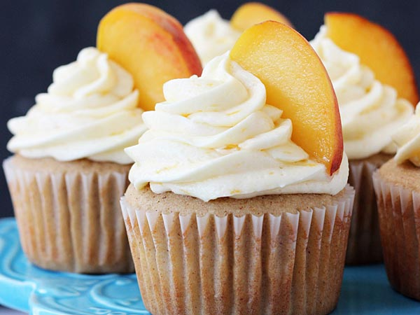 Peaches fleck the batter and fill the frosting in these juicy little bites of summer. (via Life, Love & Sugar)