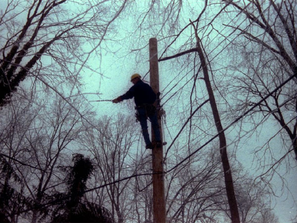 Linesman Joe Gotzon working at the top of a pole in Tredyffrin Township on Jan. 12, 1994, as crews from Peco and PP&amp;L restored power to homes that had been in the dark for several days after a severe ice storm. (Scott S. Hamrick / Staff)<br />