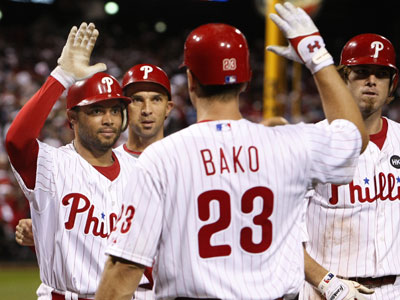 Pedro Feliz is congratulated by teammates after belting a grand slam, propelling the Phils to a 7-4 victory over the Houston Astros at Citizens Bank Park on Tuesday. (Ron Cortes / Staff Photographer)