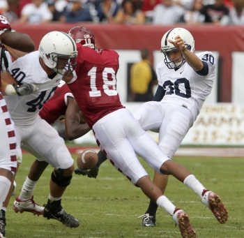 Temple&acute;s Rod Streater (18) blocks a punt by Penn State&acute;s Anthony Fera<br />in the second half of Penn State&acute;s 14-10 victory over Temple on Saturday. ( Charles Fox / Staff<br />Photographer )