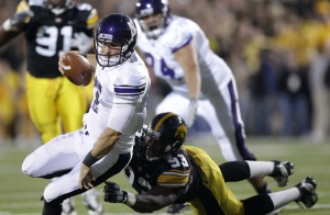Northwestern quarterback Dan Persa is tackled by Iowa defensive<br />lineman Mike Daniels last week. (AP Photo/Charlie Neibergall)