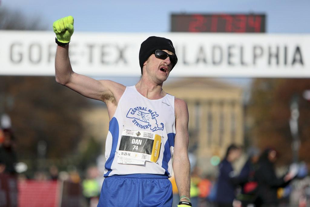 Dan Vassallo, of Peabody, Mass.,  gestures after winning the men´s division of the Philadelphia Marathon with an unofficial time of 2:17:28, Sunday Nov. 23, 2014, in Philadelphia.  (AP Photo/ Joseph Kaczmarek)