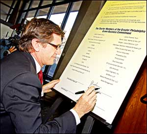 Pierre Brondeau of Rohm & Haas is the first to sign the ´Charter Members of the Greeter Philadelphia Green Business Commitment´ at Tuesday morning´s event. (Photo: Tommy Leonardi)