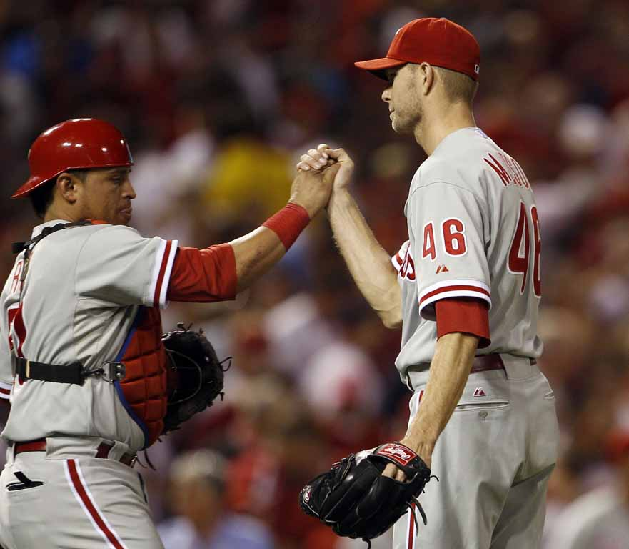 Phillies´ catcher Carlos Ruiz and Ryan Madson celebrate their game three NLDS game against the St. Louis Cardinals in St. Louis, Mo on Tuesday, October 4, 2011.  (Yong Kim / Staff Photographer)
