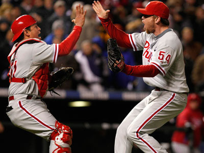 Carlos Ruiz and Brad Lidge celebrate at the end of the game on Monday. (Ron Cortes / Staff Photographer)