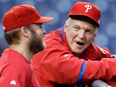 Charlie Manuel (right) chats with Eric Bruntlett before Game 3 of the World Series.  (AP Photo/Matt Slocum)