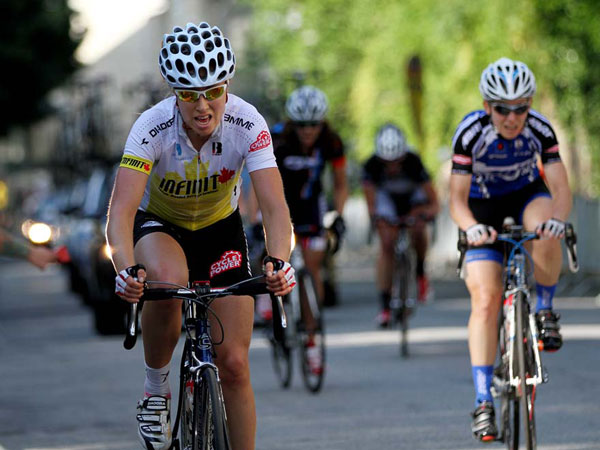 """Veronica Bourgon, center, racing for Infinite Nutrition/Cyclepower, guts it out on her second trip up """"The Wall´ during the 2013 women´s Philly Cycling Classic Race. We chronicle the color and fun of the Philly Cycling Classic that begins and ends in Manayunk.  (Michael Bryant/ Staff Photographer)"""