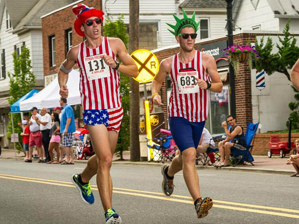 Two patriotically dressed runners finish the Pitman Freedom 4 Mile race on July 4, 2013. (Photo via Facebook)