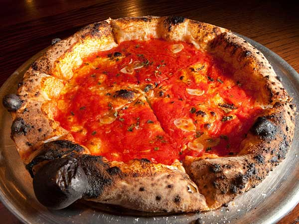 Contender for the city´s best: A simple marinara pie topped with hand-crushed tomatoes, slivered garlic, and oregano at Pizzeria Vetri.