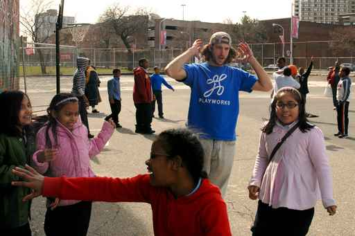 "Playworks was active at Charles Drew Elementary in West Philadelphia last year, but the school wasn´t able to keep the program.  Here, ""Coach Ben"" Gibboney directs a game on the playground. (Tom Gralish/staff)"