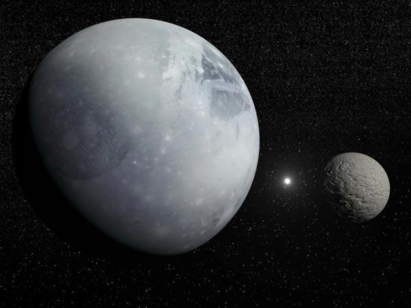 Pluto and its big moon, Charon.