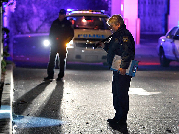 Police investigate the crime scene in the parking lot of a Rite-Aid store at Levick Street and Torresdale Avenue in the Tacony section of Philadelphia, after police shot an armed gunman.  (For the Daily News/ Joseph Kaczmarek)