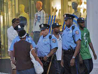 In June 2009, Philadelphia police kept a heavy presence on South Street after a blitz of young people to the area. ( John Costello/File)