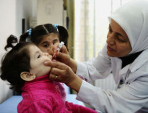 Polio vaccine is given as part of a UNICEF-supported program in Damascus. With 10 cases in Syria, nations nearby are ramping up their own vaccinations. (OMAR SANADIKI / UNICEF)