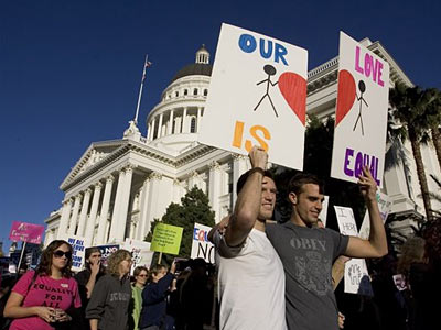 Daniel Powell and Anders Bollingmo, both of San Francisco, are two of about 2,500 protesters who marched around the state Capitol in Sacramento, Calif., Sunday, Nov. 9, 2008. (AP Photo/Robert Durell)