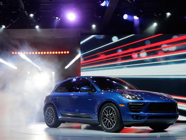 The new Porsche Macan S is introduced at the Los Angeles Auto Show in Los Angeles, Tuesday, Nov. 19, 2013. (AP Photo/Chris Carlson)