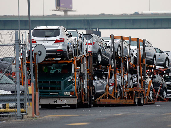 Hyundai automobiles sit on a transporter in a lot in South Philadelphia on Thursday, May 22, 2014.  ( Yong Kim / Staff Photographer )