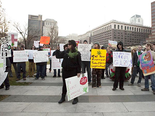 Supporters of the repeal of federal marijuana prohibition laws rally at Independence Mall on Dec. 15, 2012. In an act of civil disobedience, many chose to light joints at 4:20 p.m. disregarding police presence nearby. ( Hillary Petrozziello / Philly.com )