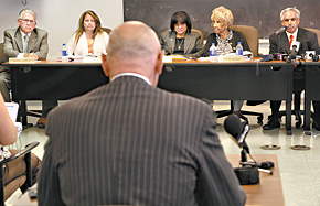 At a meeting before the Philadelphia Housing Authority board, Clifford E. Haines, attorney for beleaguered executive director Carl R. Greene, addresses board members (from left) Patrick Eiding, Debra Brady, Jannie L. Blackwell, Nellie Reynolds, and John F. Street, the chairman. (Laurence Kesterson / Staff Photographer)