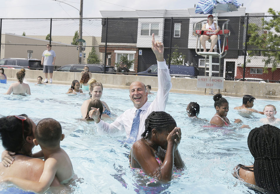 Phila. Councilman Mark Squilla surprised everyone when he too jumped into the pool at the Murphy Recreation Center in South Phila. on June 22, 2017. Just in time, Mayor Kenney, city brass and community members to participate in a dedication ceremony for the new playground equipment at Murphy Recreation Center and will also announce the official opening of public pools for the 2017 summer season.  ( ELIZABETH ROBERTSON / Staff Photographer )