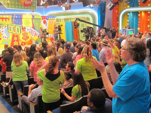 """The Price Is Right"" crowd maintains its energy during a commercial break. Fans who´ve watched the show on TV come from everywhere to see it in all its frenetic glory."