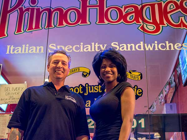 Primo Hoagie shop co-owner Ted Cox and girlfriend Ashley Floyd will serve veterans free Thanksgiving dinners