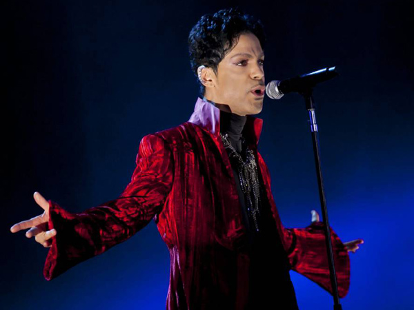 FILE - In this Aug. 9, 2011 file photo, U.S. musician Prince performs during his concert at the Sziget Festival on the Shipyard Island, northern Budapest, Hungary. The singer released a surprise new single on Friday just before midnight. (AP Photo/MTI, Balazs Mohai, File)