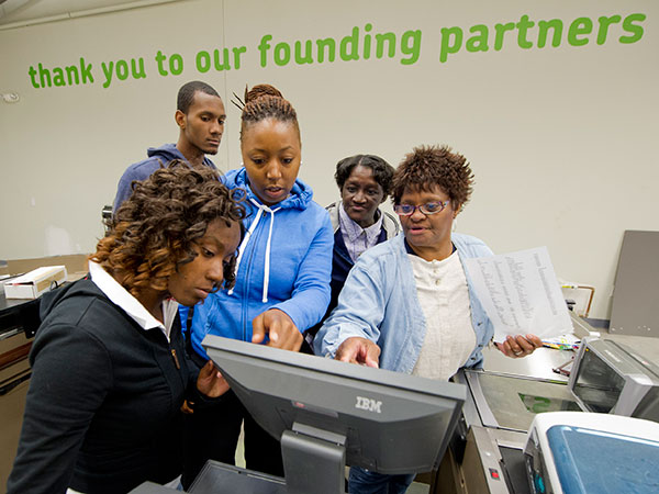 Cashiers and customer service associates at the new Fare & Square supermarket in Chester try out the new cash registers at the store Sept. 24, 2013.  The grand opening for the non-profit supermarket will be Sept. 28, 2013.  The cashiers, all from Chester, are (from left): Kiyana Mills, Brandon Freeman, Karen Kelly, Tammy Jones and Ruth Richardson.  ( CLEM MURRAY / Staff Photographer )
