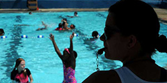 Nicola Cianci, 22, Juniata Park, a lifeguard for two years, watches over the kids at the Northern Liberties Pool, located at 321 Fairmount Ave., on July 29, 2015.  ( CLEM MURRAY / Staff Photographer )