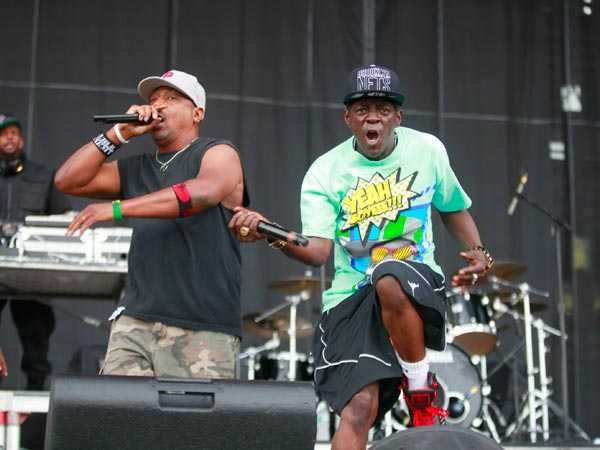 Chuck D (Left) and Flavor Flav from Public Enemy thrill the concertgoers at the Budweiser Made in America festival Saturday, August 31, 2013. ( DAVID SWANSON / Staff Photographer )