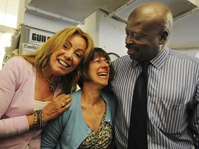 Philadelphia Daily News Reporters Barbara Laker (left) and Wendy Ruderman,<br />and Daily News Editor Michael Days react to the news. (Sarah J. Glover)