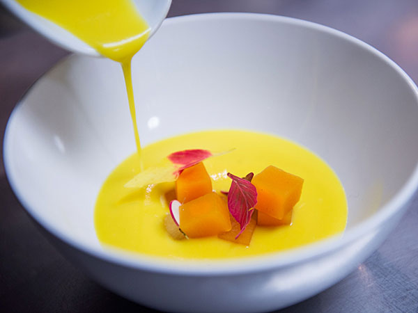 Sweet and Sour Pumpkin atop Butternut Squash Soup via Pumpkin Restaurant.