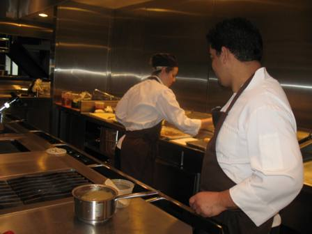 Chef de cuisine Alex Urena (right) in the kitchen at R2L last fall.