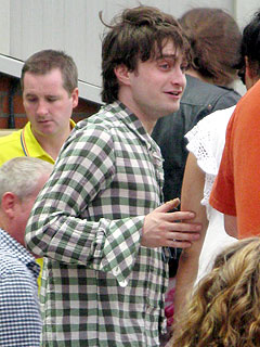 Daniel Radcliffe looking a little bleary in London.