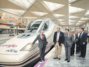 International officials are pictured in front of the high-speed train (AVE), linking Zaragoza to Madrid on May 29, 2009. (PEDRO ARMESTRE/AFP/Getty Images)