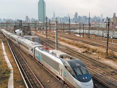Amtrak´s new Acela Express train is seen against the Manhattan skyline as it heads to Boston. The Acela Express is the first high-speed rail service in North America, moving across the Northeast at a top speed of 150 mph. (DOUG KANTER/AFP/Getty Images)