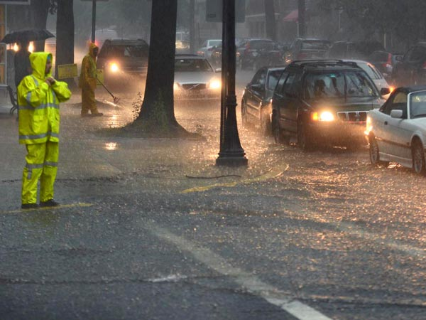 Borough public works personnel are at the intersection of Haddon Avenue and Kings Highway in downtown Haddonfield August 13, 2013 to clear the drains but they were not clogged - just too much water, too quickly, overwhelming storm drains.  ( TOM GRALISH / Staff Photographer )