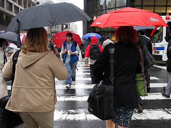 File photo: Philadelphia commuters and their umbrellas during the morning commute along N. 16th at Market St. (Alejandro A. Alvarez / Staff<br />Photographer)