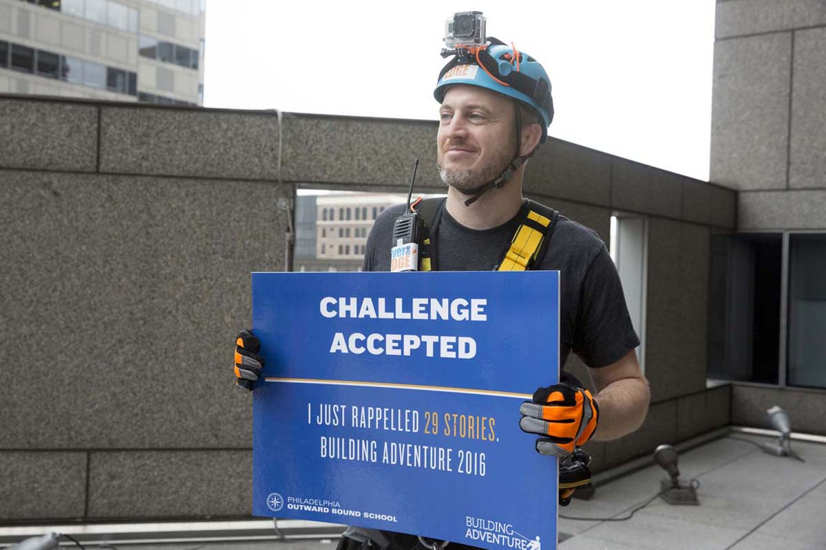 Mike Gadsby, cofounder of 03 World, lands on the ground after rappelling down Two Commerce Square. <br /><br /><br />