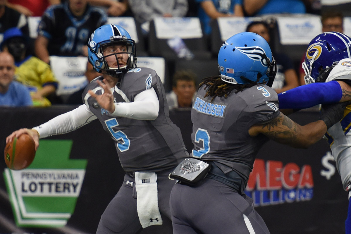 Philadelphia Soul Quarterback DAn Raudabaugh, left, looks downfield for a receiver as Jermaine Richardson, center and Tampa Bay Storm´s DAvid Washington, right,  battle it out in the first quarter of Round One Arena Football playoff game Sunday Aug. 7, 2016 in Allentown, Pa. (Bradley C Bower/Philadelphia Inquirer)