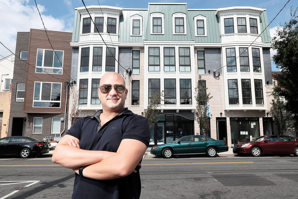 Amit Azoulay, a former art student, stands in front of his buidlign at 1512 Frankford in Fishtown, it is his design, overseen and fitted by architects.