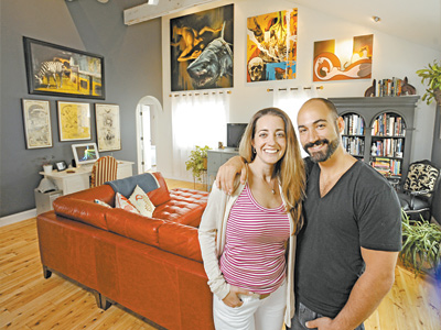 Alicia and Victor Grasso in the middle of their open-floor-plan renovated beach bungalow in North Cape May.  ( Clem Murray / Staff Photographer )