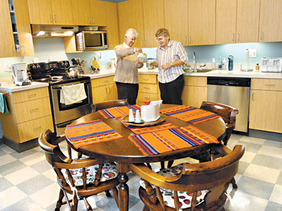 Sister Ann Provost, left; and Sister Margery Lowry in the kitchen of their convent, Mercy Neighborhood Ministries. (April Saul/Staff Photographer)