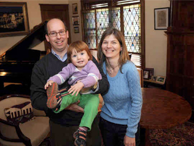Andy and Szilvia Szekely with their year-old daughter, Anna, in their Lansdale home. It was built in 1927 but has been remade inside to feature the style of 19th-century Hungary. (Sharon Gekoski-Kimmel / Staff Photographer)