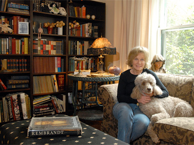 Frances Shultz´s and her dog Bettie in the front living room with library of her home in Lansdowne.(Ron Tarver / Staff Photographer)